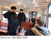 Купить «Отработка сотрудниками полиции пресечения нарушения общественного порядка в вагоне электропоезда», фото № 26482329, снято 26 марта 2015 г. (c) Free Wind / Фотобанк Лори