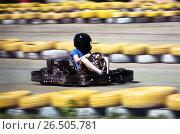 Carting - driver in helmet on kart circuit. Стоковое фото, фотограф Dmitriy Melnikov / Фотобанк Лори
