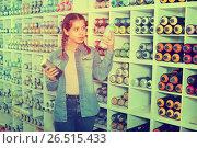 Купить «Portrait of girl choosing paint color in aerosol can in art sho», фото № 26515433, снято 12 апреля 2017 г. (c) Яков Филимонов / Фотобанк Лори