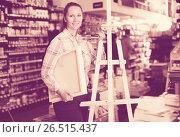 Купить «Woman holding supplies for painting», фото № 26515437, снято 12 апреля 2017 г. (c) Яков Филимонов / Фотобанк Лори