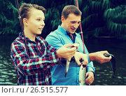 Family with catched fish. Стоковое фото, фотограф Яков Филимонов / Фотобанк Лори