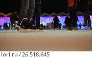 Купить «Moscow. Skating rink in the open air. People skate in the winter. Evening time. Christmas lights.», видеоролик № 26518645, снято 4 апреля 2017 г. (c) Mikhail Davidovich / Фотобанк Лори
