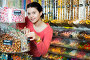 girl buying candies at shop, фото № 26518789, снято 22 марта 2017 г. (c) Яков Филимонов / Фотобанк Лори