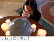 Купить «sad woman with funerary urn praying at church», фото № 26519733, снято 20 марта 2017 г. (c) Syda Productions / Фотобанк Лори