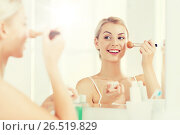 Купить «woman with makeup brush and powder at bathroom», фото № 26519829, снято 13 февраля 2016 г. (c) Syda Productions / Фотобанк Лори