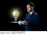 Купить «businessman with tablet pc and lightbulb», фото № 26519877, снято 9 марта 2017 г. (c) Syda Productions / Фотобанк Лори
