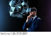 Купить «businessman in virtual reality headset over black», фото № 26519881, снято 9 марта 2017 г. (c) Syda Productions / Фотобанк Лори