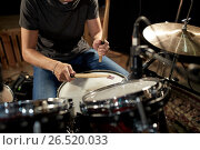 Купить «male musician playing drums and cymbals at concert», фото № 26520033, снято 18 августа 2016 г. (c) Syda Productions / Фотобанк Лори