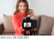 Купить «woman with bronzer and camera recording video», фото № 26520081, снято 22 декабря 2016 г. (c) Syda Productions / Фотобанк Лори