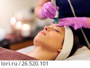 Купить «woman having microdermabrasion facial treatment», фото № 26520101, снято 26 января 2017 г. (c) Syda Productions / Фотобанк Лори