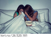Купить «scared teenage girls watching horror on tv at home», фото № 26520181, снято 14 ноября 2015 г. (c) Syda Productions / Фотобанк Лори