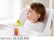 Купить «happy baby girl sitting in highchair at home», фото № 26520469, снято 24 января 2017 г. (c) Syda Productions / Фотобанк Лори