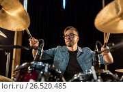 Купить «male musician playing drums and cymbals at concert», фото № 26520485, снято 18 августа 2016 г. (c) Syda Productions / Фотобанк Лори