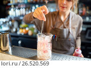 Купить «bartender with cocktail stirrer and glass at bar», фото № 26520569, снято 7 февраля 2017 г. (c) Syda Productions / Фотобанк Лори