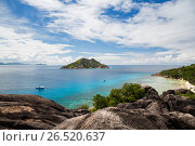 island and boats in indian ocean on seychelles (2017 год). Стоковое фото, фотограф Syda Productions / Фотобанк Лори