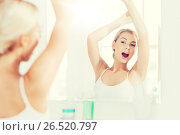 Купить «woman yawning in front of mirror at bathroom», фото № 26520797, снято 13 февраля 2016 г. (c) Syda Productions / Фотобанк Лори