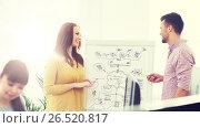 Купить «creative team with scheme on flipboard at office», фото № 26520817, снято 27 февраля 2016 г. (c) Syda Productions / Фотобанк Лори
