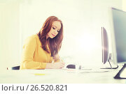 Купить «creative female office worker writing to notebook», фото № 26520821, снято 27 февраля 2016 г. (c) Syda Productions / Фотобанк Лори