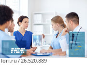 Купить «group of doctors with x-ray on tablet pc at clinic», фото № 26520889, снято 14 марта 2015 г. (c) Syda Productions / Фотобанк Лори