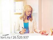Купить «businesswoman with calculator counting at office», фото № 26520937, снято 31 июля 2016 г. (c) Syda Productions / Фотобанк Лори
