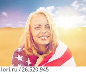 Купить «happy woman in american flag on cereal field», фото № 26520945, снято 31 июля 2016 г. (c) Syda Productions / Фотобанк Лори