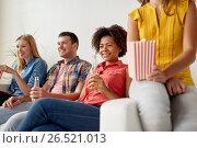 Купить «happy friends with popcorn watching tv at home», фото № 26521013, снято 14 августа 2016 г. (c) Syda Productions / Фотобанк Лори