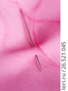 Купить «sewing needle with thread stuck into pink fabric», фото № 26521045, снято 29 сентября 2016 г. (c) Syda Productions / Фотобанк Лори