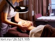 Купить «beautician doing face massage to woman at spa», фото № 26521105, снято 26 января 2017 г. (c) Syda Productions / Фотобанк Лори