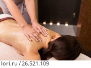 Купить «woman lying and having back massage at spa parlor», фото № 26521109, снято 26 января 2017 г. (c) Syda Productions / Фотобанк Лори