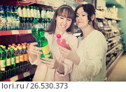 Купить «Portrait of female customers shopping in market», фото № 26530373, снято 21 августа 2019 г. (c) Яков Филимонов / Фотобанк Лори