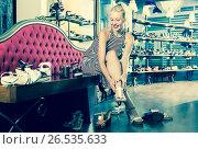 Купить «Happy girl trying on chosen shoes», фото № 26535633, снято 11 июля 2020 г. (c) Яков Филимонов / Фотобанк Лори