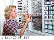 Купить «mature woman in sewing store», фото № 26541985, снято 23 мая 2019 г. (c) Яков Филимонов / Фотобанк Лори
