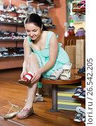 Купить «Female buyer is trying on sandals for summer season», фото № 26542205, снято 10 мая 2017 г. (c) Яков Филимонов / Фотобанк Лори