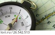 Купить «Compass on the map», видеоролик № 26542513, снято 10 мая 2017 г. (c) Дмитрий Брусков / Фотобанк Лори