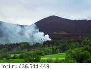 Купить «View to Hoernle mountain, forest fire with dense smoke, Germany, Bavaria, Oberbayern, Upper Bavaria, Bad Kohlgrub», фото № 26544449, снято 19 мая 2015 г. (c) age Fotostock / Фотобанк Лори