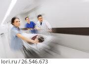 Купить «medics and patient on hospital gurney at emergency», фото № 26546673, снято 3 декабря 2015 г. (c) Syda Productions / Фотобанк Лори