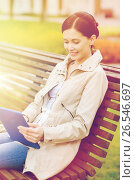 Купить «woman with tablet pc sitting on bench in park», фото № 26546697, снято 10 мая 2015 г. (c) Syda Productions / Фотобанк Лори