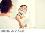 Купить «man shaving beard with razor blade at bathroom», фото № 26547033, снято 15 января 2016 г. (c) Syda Productions / Фотобанк Лори