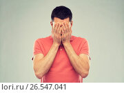 Купить «man in t-shirt covering his face with hands», фото № 26547041, снято 15 января 2016 г. (c) Syda Productions / Фотобанк Лори