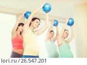 Купить «happy pregnant women exercising with ball in gym», фото № 26547201, снято 5 марта 2016 г. (c) Syda Productions / Фотобанк Лори