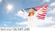 Купить «happy young woman with american flag over blue sky», фото № 26547245, снято 31 июля 2016 г. (c) Syda Productions / Фотобанк Лори