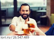Купить «man clinking beer glass with friends at restaurant», фото № 26547489, снято 8 ноября 2015 г. (c) Syda Productions / Фотобанк Лори