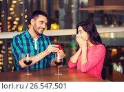 Купить «man giving engagement ring to woman at restaurant», фото № 26547501, снято 8 ноября 2015 г. (c) Syda Productions / Фотобанк Лори