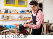 Купить «Craftsman working on woodworking machine», фото № 26550381, снято 8 апреля 2017 г. (c) Яков Филимонов / Фотобанк Лори