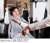 Купить «Upset woman in hairdress salon», фото № 26552237, снято 7 марта 2017 г. (c) Яков Филимонов / Фотобанк Лори