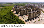 Купить «Aerial view of new residential area in the russian city - Voronezh. 4K», видеоролик № 26552297, снято 12 июня 2017 г. (c) ActionStore / Фотобанк Лори