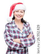 Купить «Brunette woman in pajama and red christmas cap on white background», фото № 26552829, снято 2 января 2017 г. (c) Константин Лабунский / Фотобанк Лори