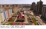 Купить «Aerial view of new housing estate in the russian city - Voronezh. Nursery. 4K», видеоролик № 26553261, снято 12 июня 2017 г. (c) ActionStore / Фотобанк Лори