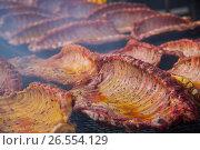 Купить «Meat ribs of pig roasting on barbecue», фото № 26554129, снято 30 апреля 2017 г. (c) Яков Филимонов / Фотобанк Лори
