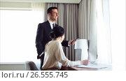 Купить «business team with papers and tablet pc at hotel», видеоролик № 26555745, снято 7 июня 2017 г. (c) Syda Productions / Фотобанк Лори